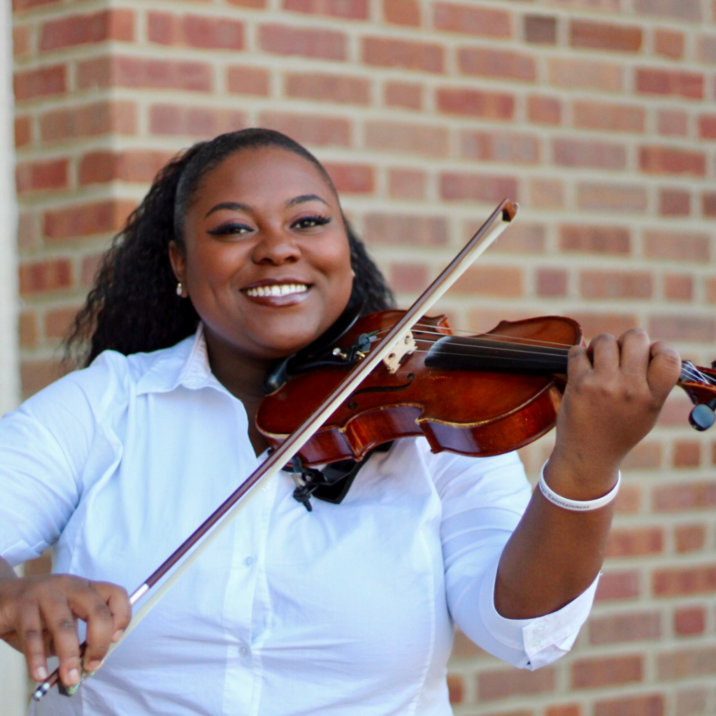 Image of Black woman playing a violin