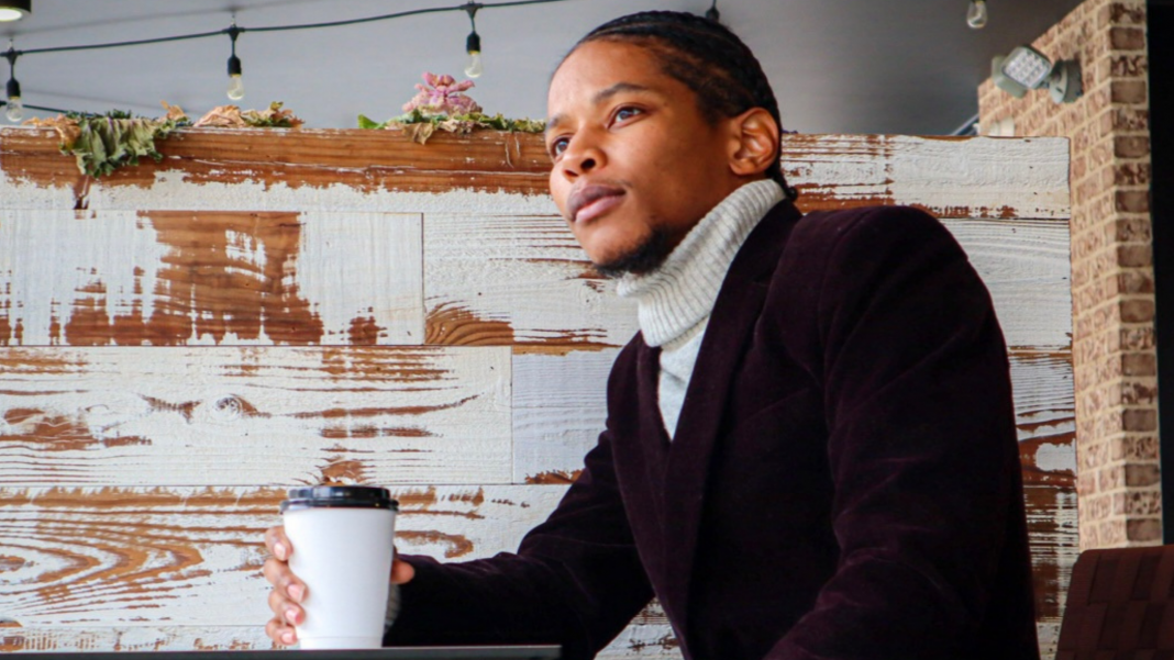 Black Man sitting with a cup of coffee